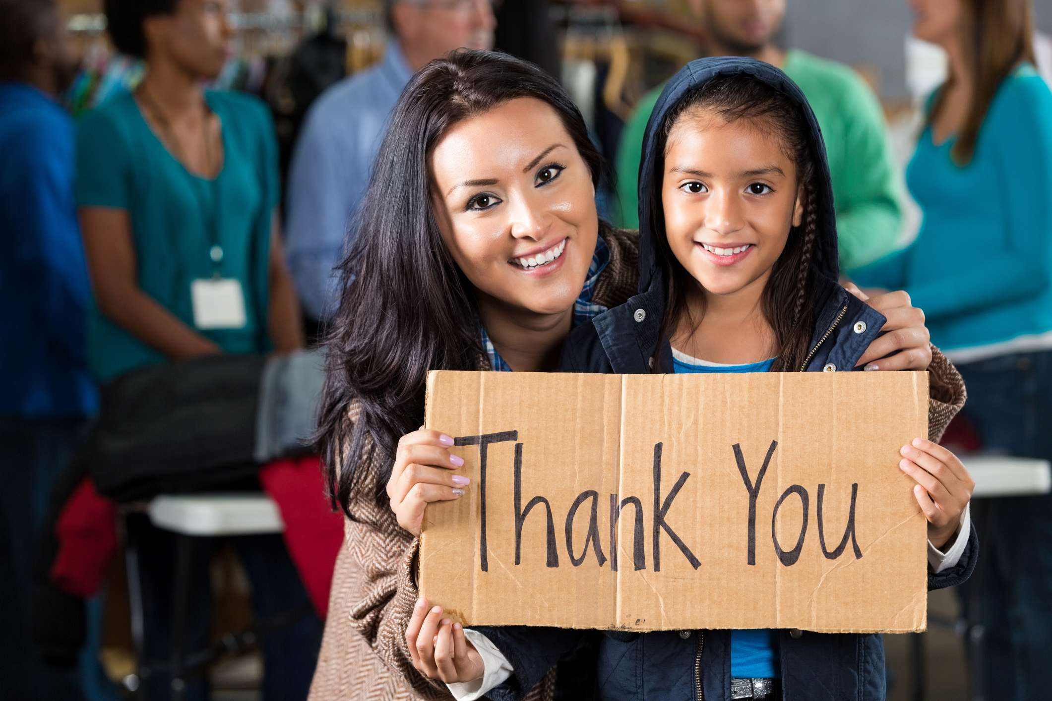 Mother and daughter at coat drive